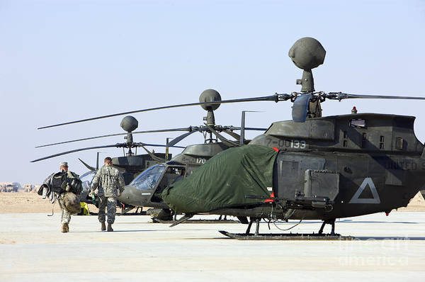 Kiowa Photograph - Oh-58d Kiowa Warrior Helicopters Parked by Terry Moore