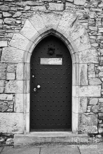 Holyrood Photograph - Old Fortified Wooden Door In The Wall Of The Abbey Courthouse Holyrood Palace Edinburgh by Joe Fox