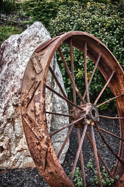 Photograph - Old Tractor Wheel by James Woody
