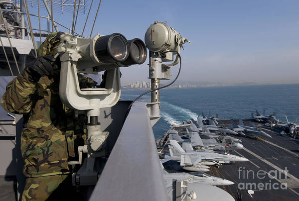 Uss Carl Vinson Photograph - Operations Specialist Seaman Stands by Stocktrek Images