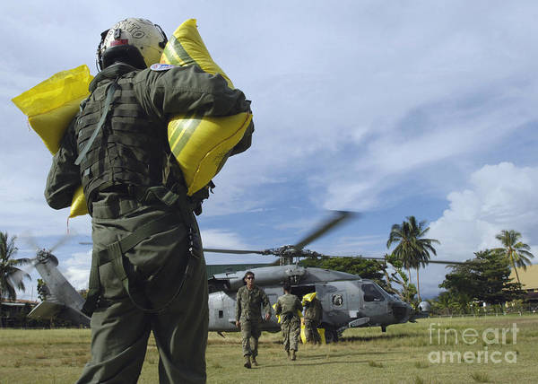 Hs Photograph - Operator Loads Rice Into An Hh-60h by Stocktrek Images