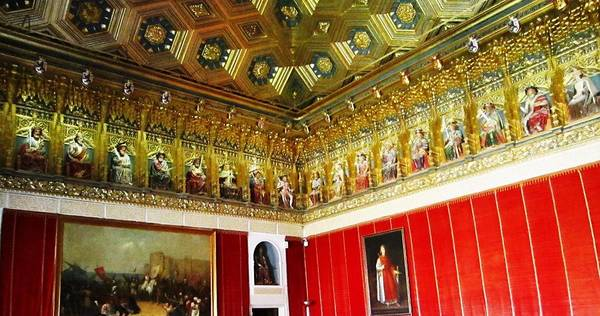 Photograph - Ornate Hall Golden Ceiling Work Of Miniature King Statues Red Wall In Segovia Castle Spain by John Shiron