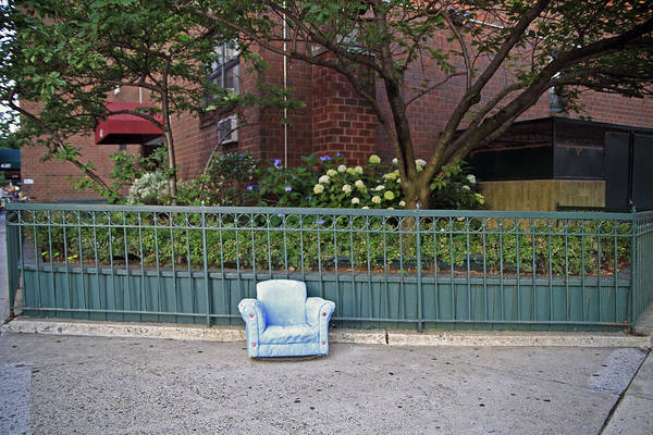 Armchair Photograph - Padded Child Size Armchair Offers Comfort On The Sidewalk Of A Greenwich Village Street, New York City, Ny, Usa by Brian Phillpotts