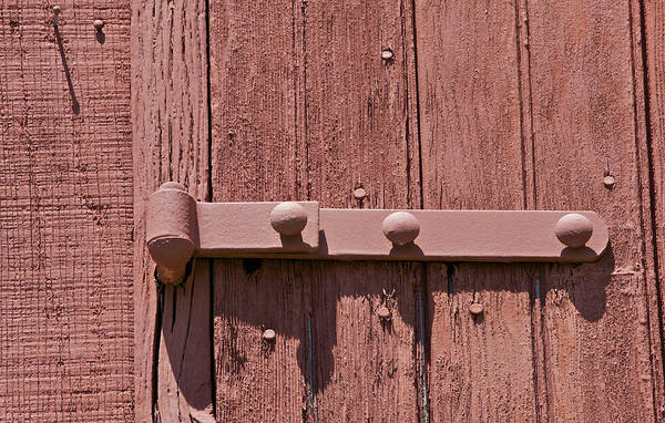 Photograph - Painted Red Iron Hinge On A Red Barn Door by David Letts