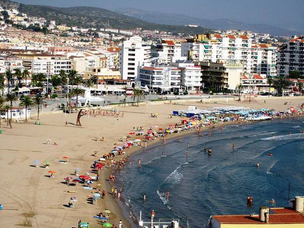 Photograph - Peniscola Beach Sea View Waterfront Swimmers At The Mediterranean In Spain by John Shiron