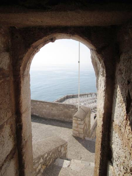 Photograph - Peniscola Castle Arched Open Doorway Sea View At The Mediterranean In Spain by John Shiron