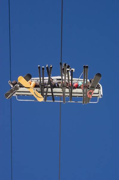 Wall Art - Photograph - People Riding On Ski Lift At Risoul by Axiom Photographic