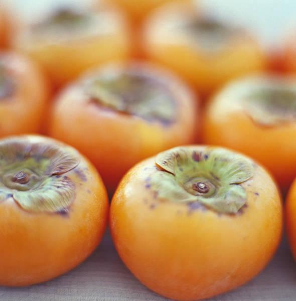 Wall Art - Photograph - Persimmon Fruits by David Munns