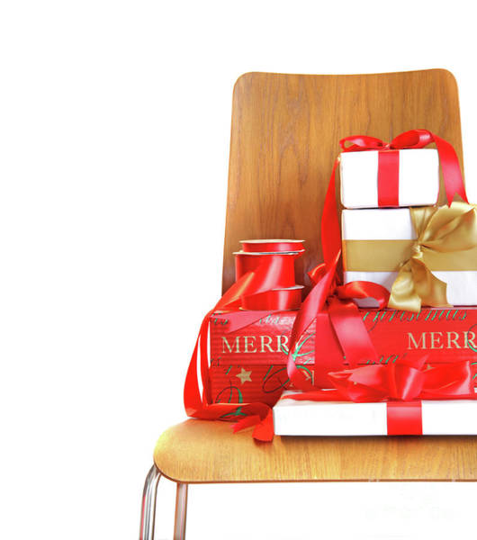 Wall Art - Photograph - Pile Of Gifts On Wooden Chair Against White by Sandra Cunningham