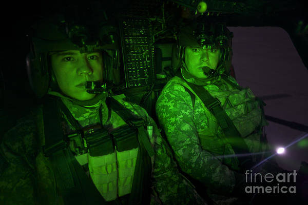 Kiowa Photograph - Pilots In The Cockpit Of An Oh-58d by Terry Moore