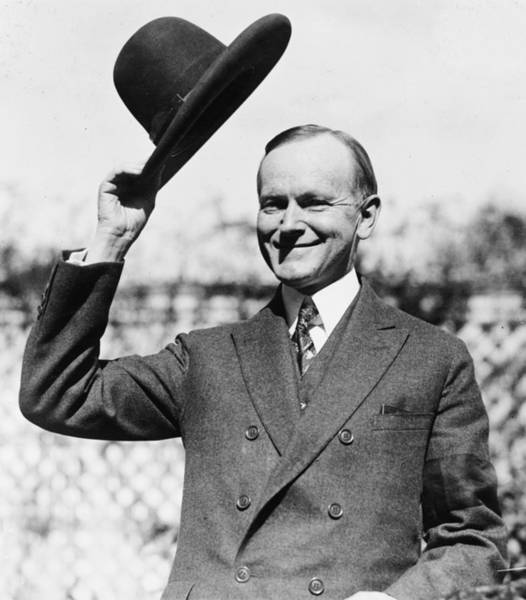 Wall Art - Photograph - President Calvin Coolidge Tips Is Hat by International  Images
