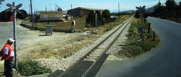 Photograph - Railroad Crossing II On The Way From Mycenae To Olympia In Greece by John Shiron