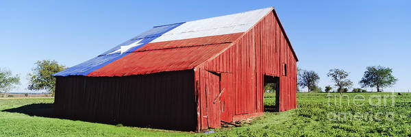 Fourth Photograph - Red Barn In Field With Texas Flag On Roof by Jeremy Woodhouse