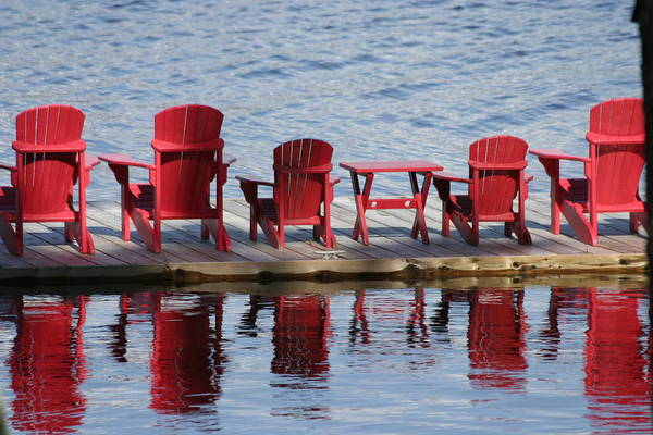 Red Muskoka Chairs Art Print by Carolyn Reinhart