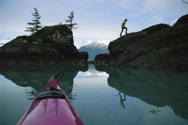Gulf Of Alaska Photograph - Reflection In Water Of Man Climbing by Kate Thompson