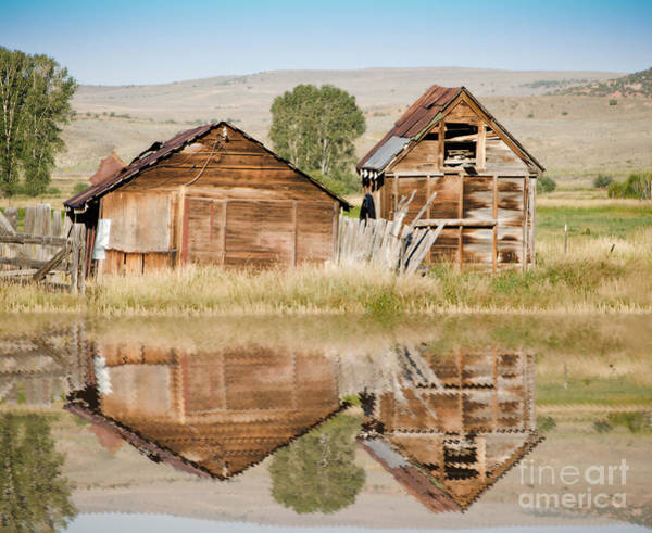 Photograph - Reflection Of An Old Building by Donna Greene