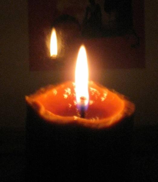 Wall Art - Photograph - Reflection Of Burning Candle by Toni Roberts