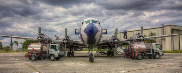 Wall Art - Photograph - Refueling -- Eal Dc-7b by William Wetmore