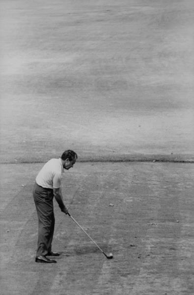 Wall Art - Photograph - Richard Nixon Playing Golf. Aug. 26 by Everett
