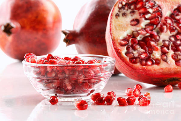 Wall Art - Photograph - Ripe Pomegranates And Glass Bowl Of Seeds On White by Sandra Cunningham