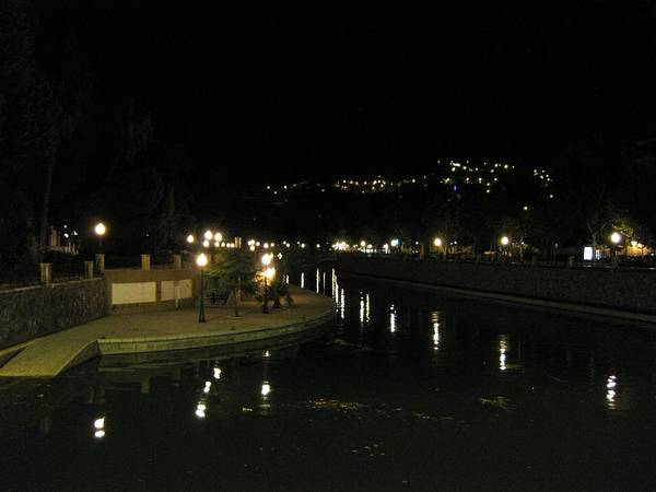Photograph - Romantic Scene Of Lamp Post Reflection By The River At Night II Granada Spain by John Shiron