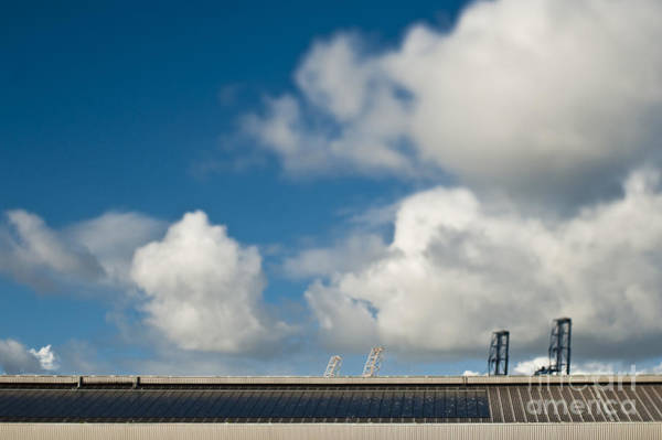 Call Building Photograph - Roof Line And Cranes At A Seaport by Eddy Joaquim