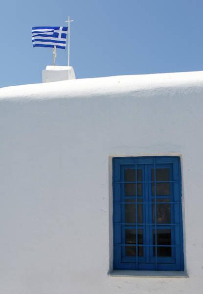 Photograph - Rooftop Flag by Lorraine Devon Wilke