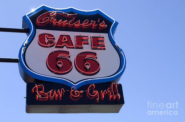 Wurlitzer Photograph - Route 66 Sign Cruisers Cafe by Bob Christopher