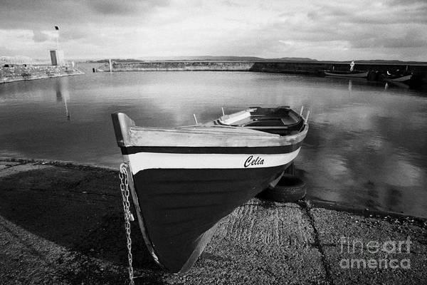 Conn Wall Art - Photograph - Row Fishing Boat In The Gortnor Abbey Harbour At Gortnaraby In Lough Conn County Mayo Ireland by Joe Fox