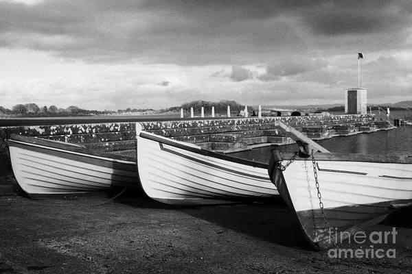 Conn Wall Art - Photograph - Row Fishing Boats In The Gortnor Abbey Harbour At Gortnaraby In Lough Conn County Mayo Ireland by Joe Fox