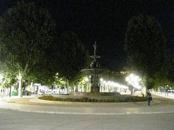 Photograph - Row Of Park Lamp Posts And Fountain At Night Granada Spain by John Shiron