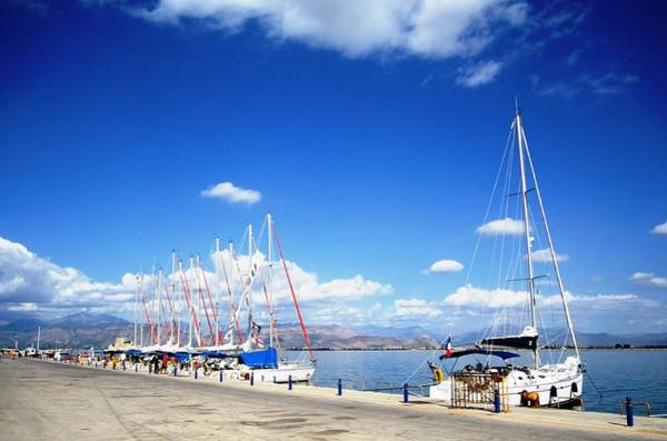 Photograph - Row Of Sailing Boats In The Beautiful Nafplion Bay Water Edge Marina In Greece by John Shiron
