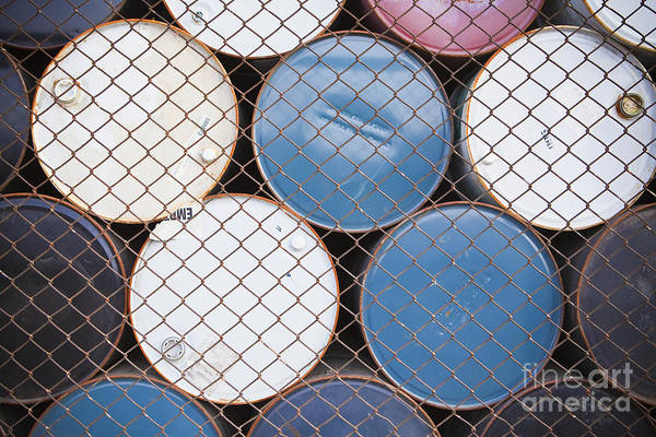 Drum Circle Wall Art - Photograph - Rows Of Stacked Barrels Behind A Fence by Paul Edmondson