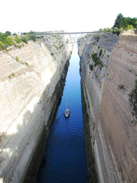 Photograph - Sailboat II Sailing Thru Corinth Canal Waters In Greece by John Shiron