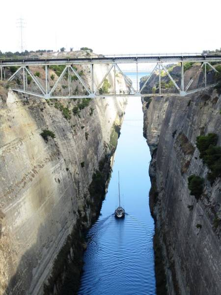 Photograph - Sailboat IIi Sailing Thru Corinth Canal Waters In Greece by John Shiron