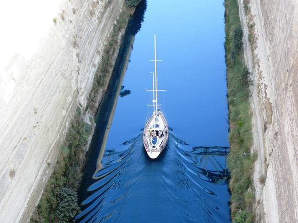 Photograph - Sailboat Sailing Thru Corinth Canal Waters In Greece by John Shiron