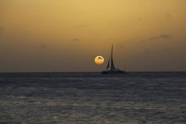 Photograph - Sailing At Sunset In The Caribbean by David Letts