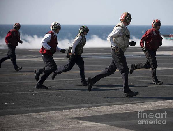 Uss Carl Vinson Photograph - Sailors Clear The Landing Area by Stocktrek Images