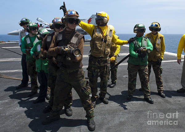 Shipmates Photograph - Sailors Fight A Simulated Fire Drill by Stocktrek Images