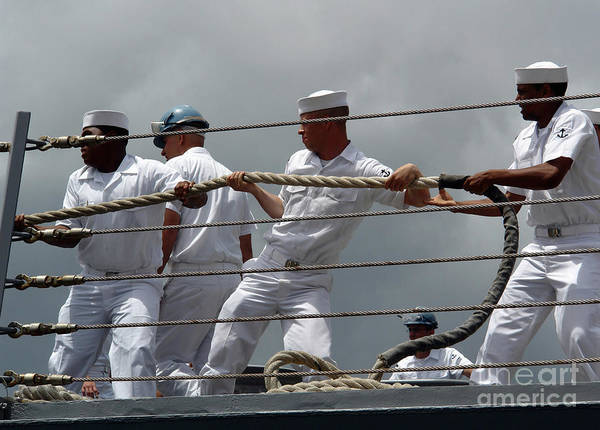 Shipmates Photograph - Sailors Heave Around On A Mooring Line by Stocktrek Images