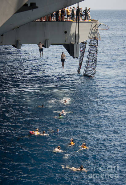 Uss Carl Vinson Photograph - Sailors Jump To The Sea During A Swim by Stocktrek Images