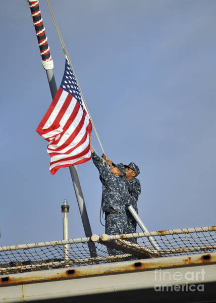 Norfolk Naval Station Wall Art - Photograph - Sailors Lower The National Ensign by Stocktrek Images