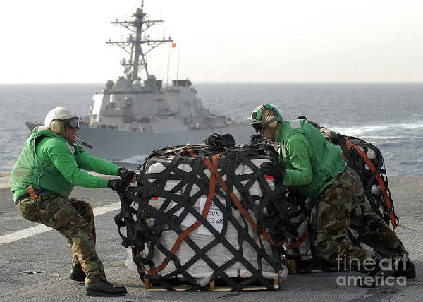 Shipmates Photograph - Sailors Move Supplies On The Flight by Stocktrek Images