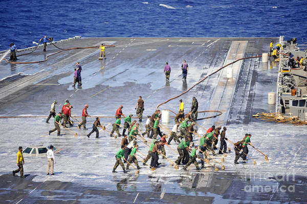 Uss George Washington Wall Art - Photograph - Sailors Perform A Flight Deck Wash by Stocktrek Images
