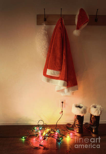 Wall Art - Photograph - Santa Costume Hanging On Coat Hook With Christmas Lights by Sandra Cunningham