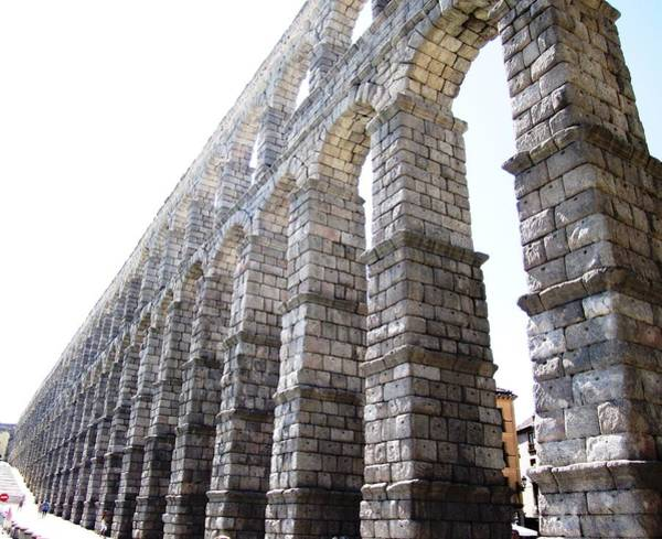 Photograph - Segovia Ancient Roman Aqueduct Architectural Granite Stone Structure II With Arches In Spain by John Shiron
