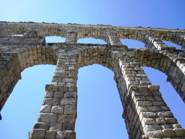 Photograph - Segovia Ancient Roman Aqueduct Architectural Granite Stone Structure IIi With Arches In Sky Spain by John Shiron
