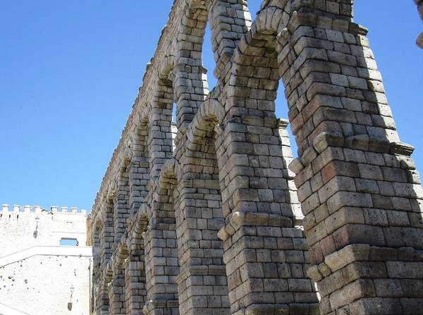 Photograph - Segovia Ancient Roman Aqueduct Architectural Granite Stone Structure Iv With Arches In Spain by John Shiron