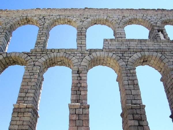 Photograph - Segovia Ancient Roman Aqueduct Architectural Granite Stone Structure Vi With Arches In Sky Spain by John Shiron