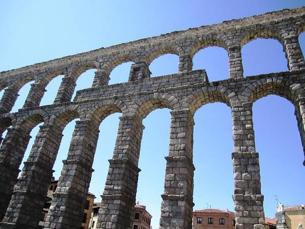 Photograph - Segovia Ancient Roman Aqueduct Architectural Granite Stone Structure With Arches In Spain by John Shiron